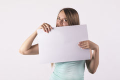 Woman holding blank white paper. Closeup Stock Photography