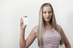 Woman holding a blank white sign Royalty Free Stock Photos