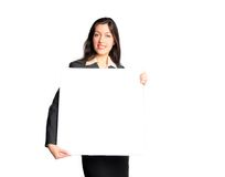 Woman holding blank white sign. Business woman in suit holds blank white sign Royalty Free Stock Photography