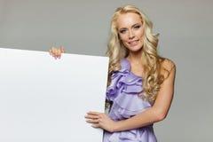 Woman holding blank whiteboard Stock Image