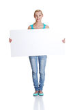 Woman is holding blank whiteboard sign Stock Photography