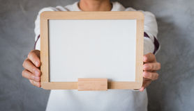 Woman holding a blank whiteboard Royalty Free Stock Photography