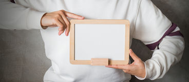 Woman holding a blank whiteboard Stock Photos
