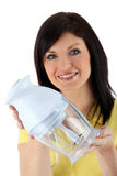 Woman holding a blender Royalty Free Stock Image
