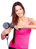Woman holding blow dryer and comb. Woman with long hair holding blow dryer and comb Royalty Free Stock Photo