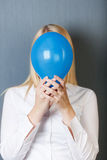 Woman Holding Blue Balloon In Front Of Face Royalty Free Stock Photos