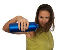 Woman holding blue bottle of water Stock Photo