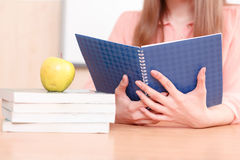 Woman holding blue copy book Stock Images