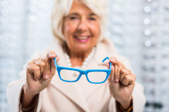 Woman holding blue frames Stock Photo