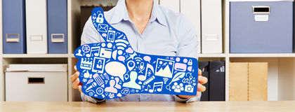 Woman holding blue thumbs up with icons Royalty Free Stock Photo