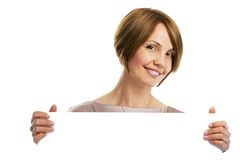 Woman holding board Stock Photo