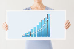 Woman holding board with 3d graph Stock Photography