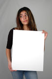 Woman holding a board-7 Stock Photos
