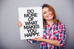 Woman holding board with motivational phrase Stock Images