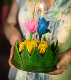 Woman holding boat with candles and flowers are given for Thaila Royalty Free Stock Images