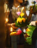 Woman holding boat with candles and flowers are given for Thaila Royalty Free Stock Photo