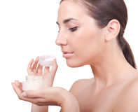 Woman holding body cream Royalty Free Stock Images