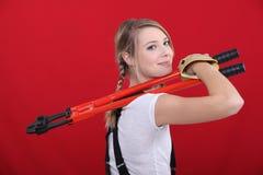 Woman holding bolt cutter Stock Photo