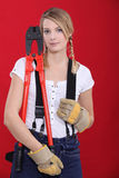 Woman holding bolt-cutters Royalty Free Stock Images