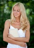 Woman holding a book Royalty Free Stock Photo