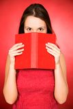 Woman holding book Stock Image