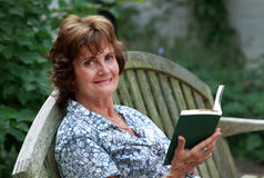 Woman holding a book open Royalty Free Stock Photo