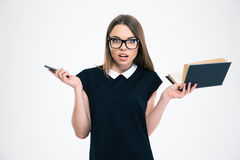Woman holding book and smartphone Royalty Free Stock Image