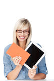 Woman holding a book and tablet Royalty Free Stock Image