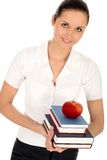 Woman holding books. Female teacher holding books and apple Royalty Free Stock Photos