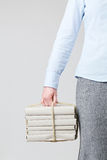 Woman Holding Books as a Parcel royalty free stock photo