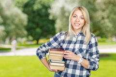 Woman holding books Stock Images