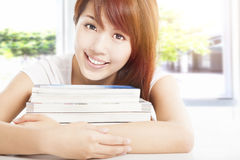 Woman holding books in the classroom Royalty Free Stock Photos