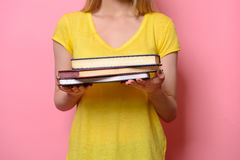 Woman holding books in hands Royalty Free Stock Photos
