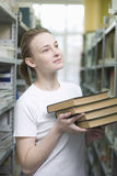 Woman Holding Books In Library Stock Photography