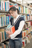 Woman holding books and looking stressed Stock Image