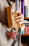 Woman holding books Royalty Free Stock Images