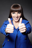 Woman holding both thumbs up Royalty Free Stock Image