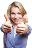 Woman holding both thumbs up Stock Images
