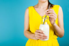 Woman holding a bottle of milk Stock Photos
