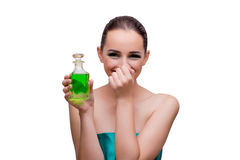 The woman holding a bottle of green perfume Royalty Free Stock Photography