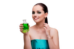 The woman holding a bottle of green perfume Royalty Free Stock Image