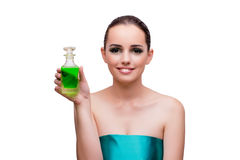 The woman holding a bottle of green perfume Stock Photo
