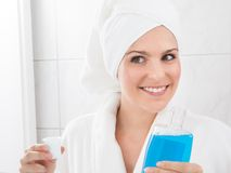 Woman holding bottle of mouthwash Stock Photography