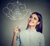 Woman holding bottle of perfume and smelling aroma Royalty Free Stock Photos