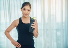 A woman holding a bottle of protein supplements on muscle drink. To strengthen health care to vigorous and beautiful stock images