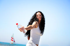 Woman holding a bottle of water. Beautiful young woman holding a bottle of water Stock Photos