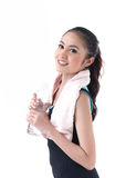 A woman holding a bottle of water. Young woman holding a bottle of water Royalty Free Stock Images