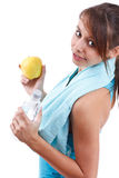 Woman holding bottle of water and apple Royalty Free Stock Images
