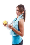 Woman holding bottle of water and apple Stock Images