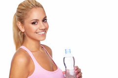 Woman holding bottle of water. Attractive young woman holding bottle of water Stock Photography